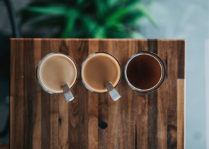 How to Use a Percolator, photo of 3 coffee cups each with light, medium, and dark cofffee