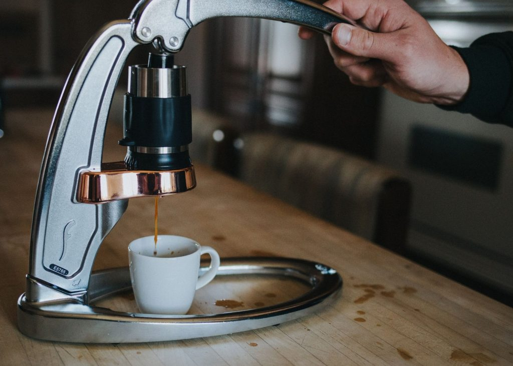 Photo of gray flair espresso maker being used to make a cup of espresso